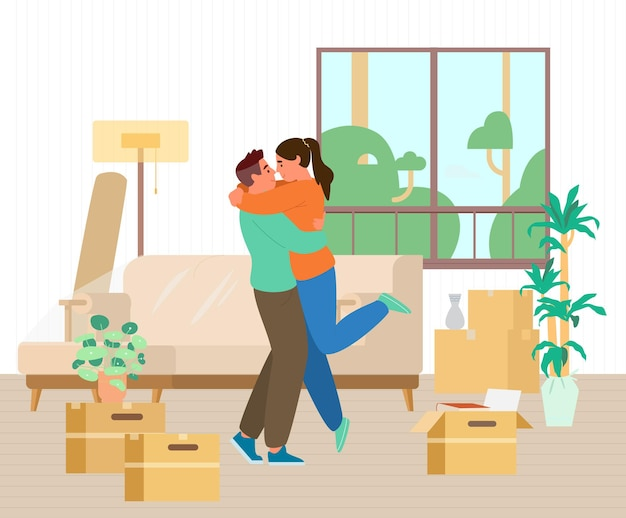 Happy young couple just moved into new house hugging among unpacked boxes and furniture