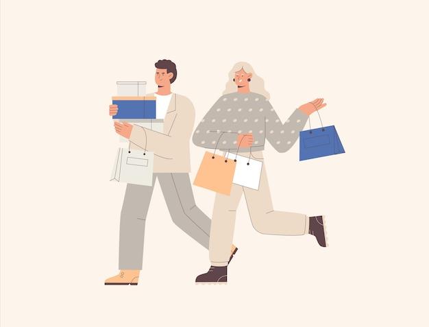 Счастливая молодая пара, мужчина и женщина, супружеская пара идут с пакетами и коробками после покупок