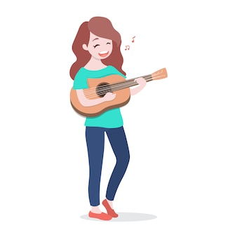 Happy young girl playing the guitar and sing a song.