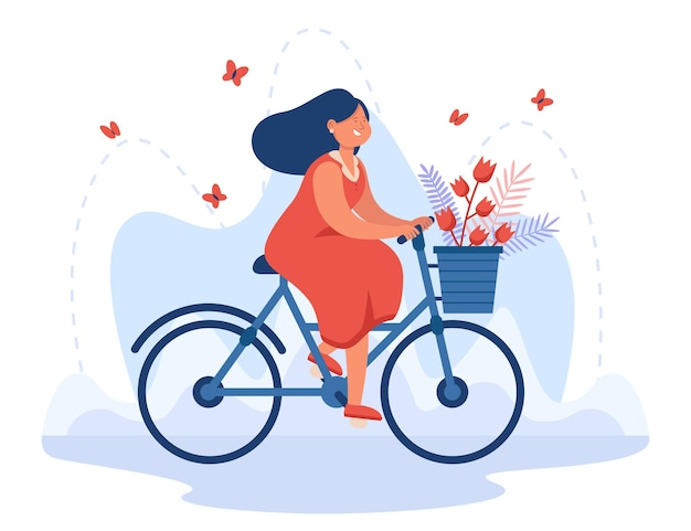 Bicicletta di guida della ragazza felice con il mazzo in cestino