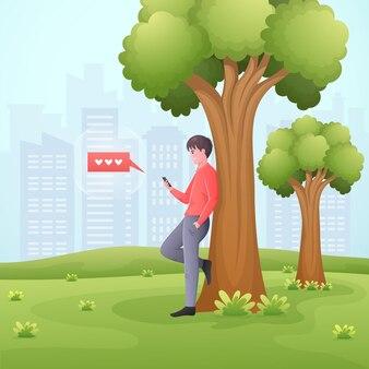 행복 한 젊은 남자는 공원에서 스마트 폰 채팅.