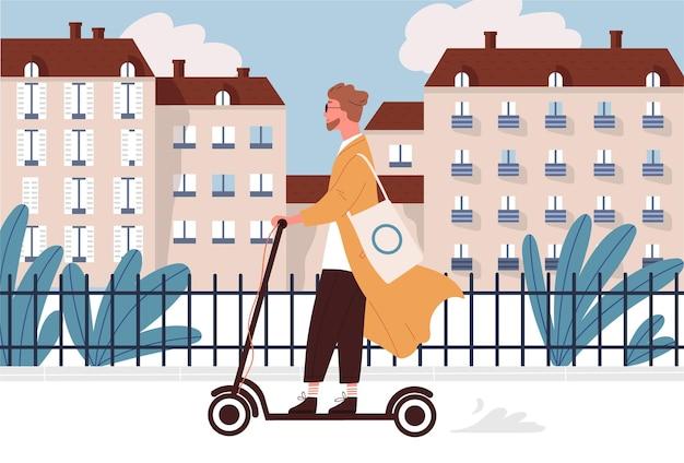 Счастливый молодой человек катается на моторизованном или электрическом самокате по улице города