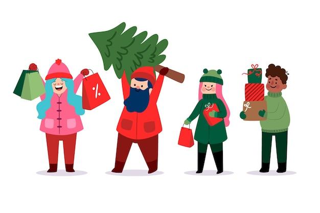 Счастливые молодые люди приносят подарки и елку