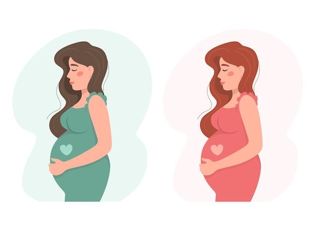 분홍색과 청록색 드레스에 행복 한 젊은 임산부.