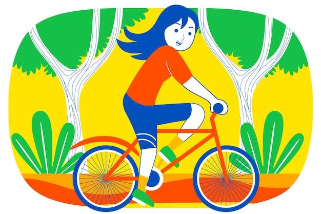 정원에서 사이클링하는 행복 한 젊은 여자.