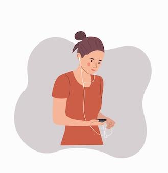 ヘッドフォンで音楽を聴いて幸せな若い女性