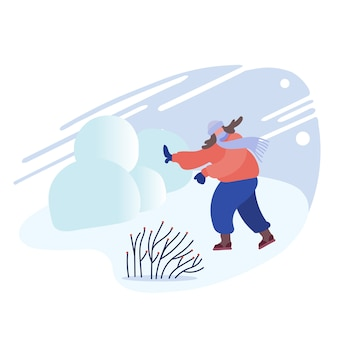Счастливая молодая женщина, играя в снежки на фоне снежного зимнего пейзажа на открытом воздухе. Premium векторы