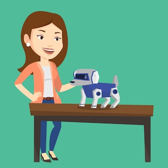 Happy young woman playing with robotic dog.
