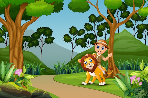 Happy zookeeper man with a lion in the jungle