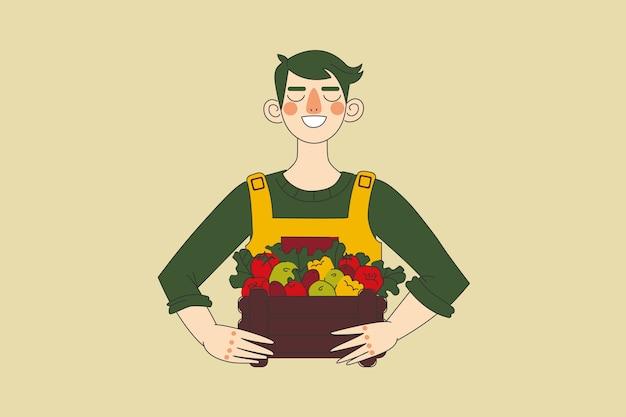 Сбор урожая, сельское хозяйство, сельское хозяйство, концепция природы. молодой счастливый человек фермер сельскохозяйственный рабочий характер, держа корзину со свежими овощами. сельский образ жизни и сбор натуральной пищи.