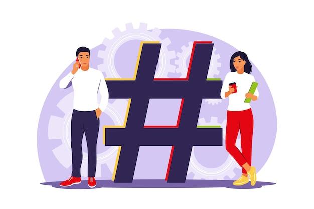ハッシュタグとソーシャルメディアの概念。ハッシュタグのシンボルを持つ若者..フラットに分離。