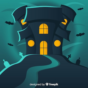 Haunted halloween house with bats and cemetery background in flat design