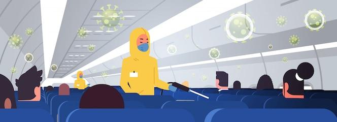 Специалисты по очистке и дезинфекции костюмов hazmat с самолетом для пассажиров. эпидемический вирус. ушанский коронавирус. пандемия. концепция риска для здоровья. интерьер горизонтальный.