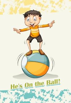 彼はボールの上にいる