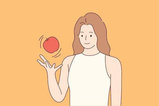Здоровье, уход, еда, веган, концепция диеты. молодые счастливые улыбающиеся женщина девушка мультипликационный персонаж бросая свежие фрукты красное яблоко в воздухе.