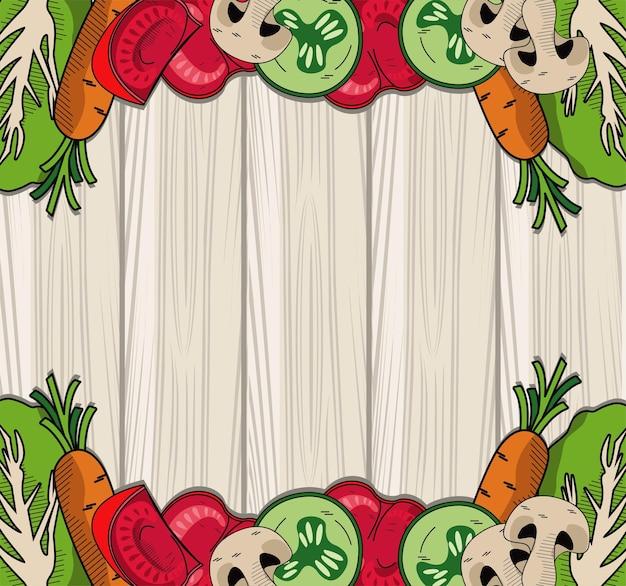 Рамка здорового и вегетарианского питания на деревянном фоне