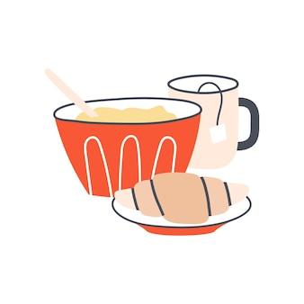 시리얼 컵 또는 차와 크루아상으로 구성된 건강한 아침 식사 아침 루틴 개념 맛있는 브런치
