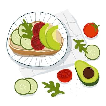 健康的な朝食、サンドイッチ、アボカド、トマトレタス、キュウリの上面図。ベジタリアン料理のコンセプト