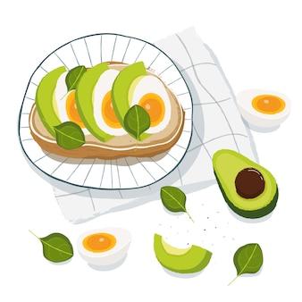 健康的な朝食、アボカド、卵、バジルのトースト、トップビュー。ベジタリアン料理のコンセプト