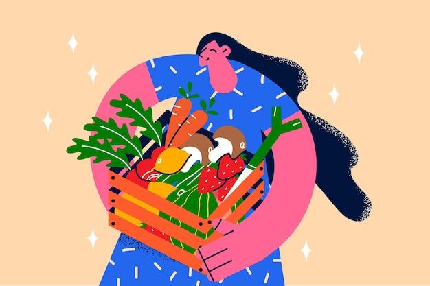 건강한 깨끗한 식사와 신선한 다이어트 개념. 건강한 식생활 벡터 삽화를 위해 신선한 농산물 채소 당근 딸기 감자 바구니를 들고 서 있는 웃고 있는 젊은 여성