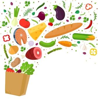 Здоровая еда падает в продуктовый бумажный пакет
