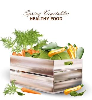 Здоровые весенние овощи в деревянной коробке