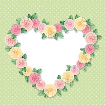 Heart frame decorated with roses on polka dots.