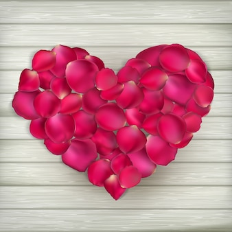 Heart made from rose petals on wooden boards.   file included
