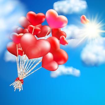 空にハート型の風船。