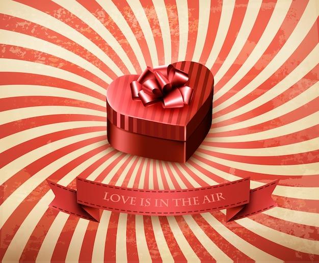Подарочная коробка в форме сердца на ретро-фоне.