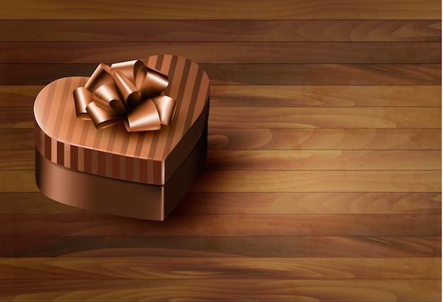 나무 바탕에 하트 모양의 선물 상자