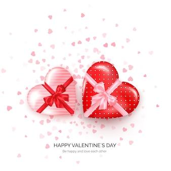 Подарочные коробки в форме сердца с шелковым бантом и конфетти. приветствие ко дню святого валентина.