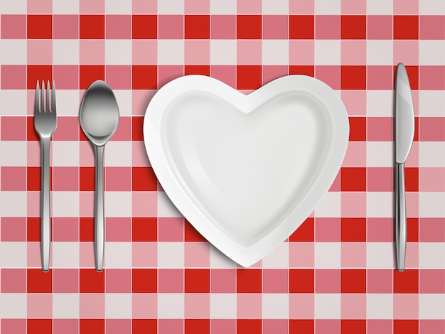 Vista superiore del piatto, della forchetta, del cucchiaio e del coltello a forma di cuore