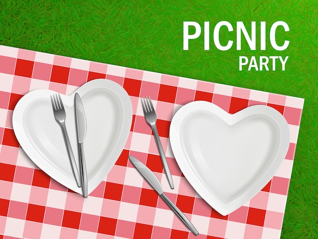 Heart shaped plate on tablecloth and green grass