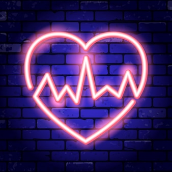 Heart with cardiogram neon signboard on brick wall