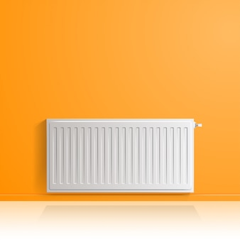 Heating radiator on orange wall, front view.