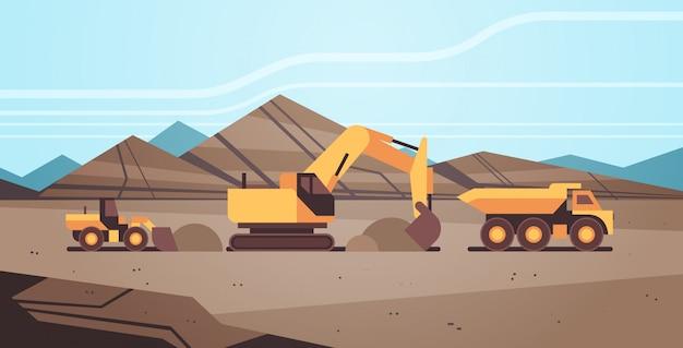 Heavy excavator loading soil on dump truck