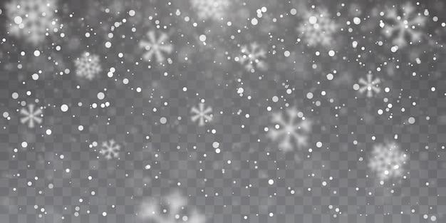 Сильный снегопад. падающие снежинки на прозрачном фоне. белые снежинки летают в воздухе.