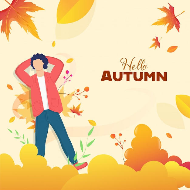 Hello autumn background with faceless young boy lying down at maple leaves.