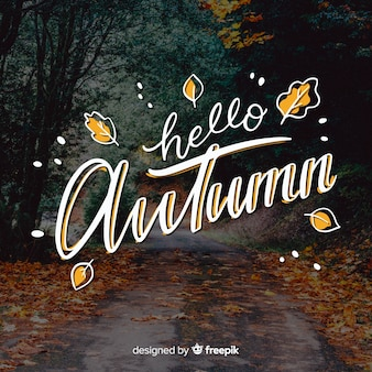 Hello autumn lettering background with photo