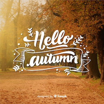 Hello autumn lettering with photo Free Vector
