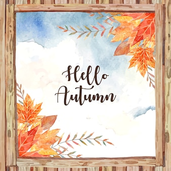 Hello autumn in the middle of wooden window frame and surround with autumn leaf such as maple and oak.