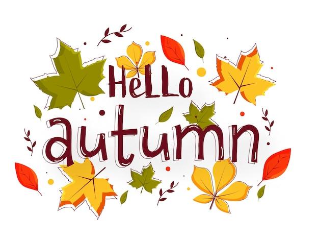 こんにちは、白い背景に飾られたカラフルな葉を持つ秋のテキスト。