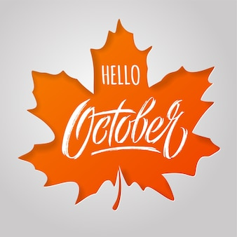 Hello october lettering with maple leaf on light background
