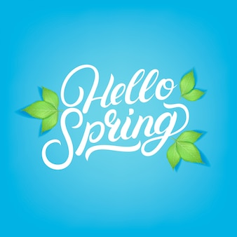 Hello spring hand written lettering with realistic green leaves.