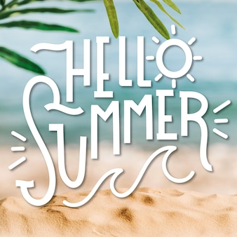 Hello summer lettering and blurred background