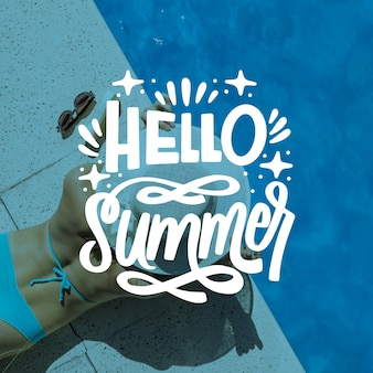 Hello summer lettering with woman by the pool