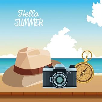 Hello summer seasonal scene with photographic camera and hat