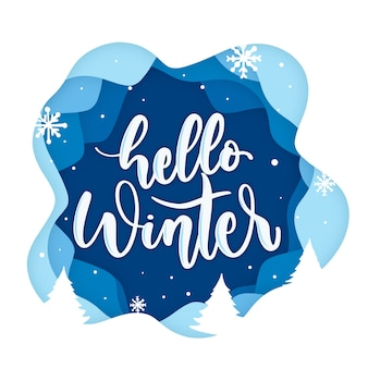 Hello winter lettering on blue background with snowflakes Premium Vector