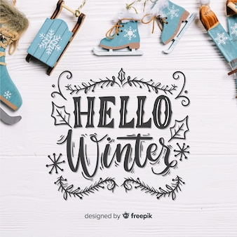 Hello winter lettering with shakes on wooden board